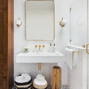 Пример оригинального дизайна: ванная комната в стиле современная классика с белой плиткой, душевой кабиной, подвесной раковиной, разноцветным полом, фасадами с утопленной филенкой, фасадами цвета дерева среднего тона, угловым душем, керамической плиткой, белыми стенами, полом из терракотовой плитки и душем с распашными дверями