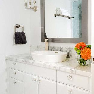 Bathroom - modern mosaic tile bathroom idea in Toronto with a vessel sink