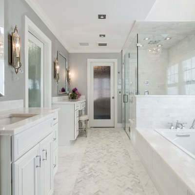 Inspiration for a timeless master white tile marble floor bathroom remodel in New York with gray walls, marble countertops, recessed-panel cabinets, white cabinets, an undermount sink and a hinged shower door