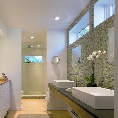 Inspiration for a farmhouse mosaic tile bathroom remodel in Burlington with a vessel sink