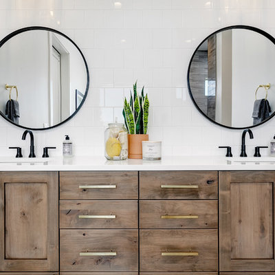 Inspiration for a large cottage master porcelain tile and white tile marble floor and white floor bathroom remodel in Boise with shaker cabinets, medium tone wood cabinets, white walls, an undermount sink, quartz countertops and white countertops