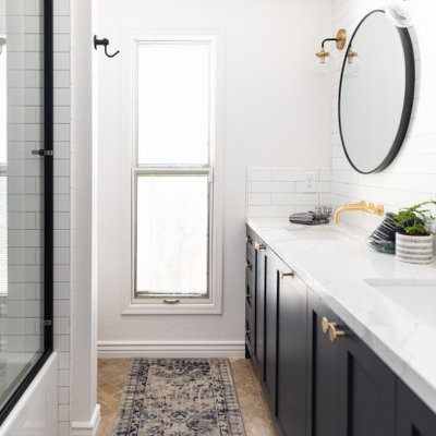 Example of a mid-sized cottage 3/4 white tile and subway tile brown floor, double-sink and travertine floor bathroom design in Phoenix with shaker cabinets, white walls, an undermount sink, white countertops, a built-in vanity, blue cabinets, a one-piece toilet and quartz countertops