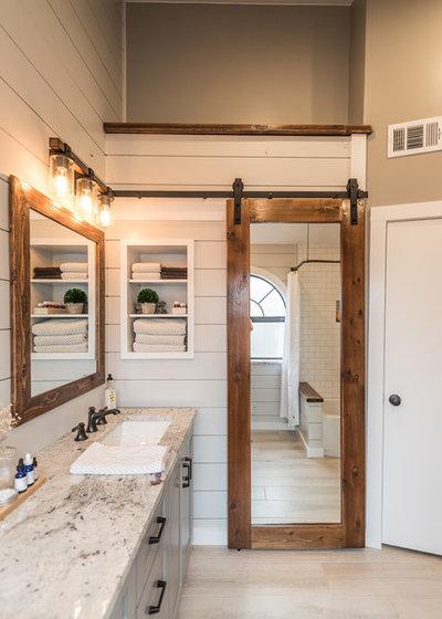Farmhouse Bathroom by Irwin Construction, LLC