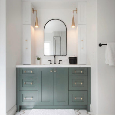 Inspiration for a mid-sized master white tile and porcelain tile porcelain tile, white floor, single-sink, wallpaper ceiling and wallpaper bathroom remodel in San Diego with recessed-panel cabinets, green cabinets, a two-piece toilet, white walls, an undermount sink, quartz countertops, a hinged shower door, white countertops and a built-in vanity