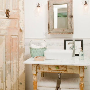 Example of a cottage chic white floor bathroom design in Los Angeles with furniture-like cabinets, distressed cabinets, white walls and a vessel sink