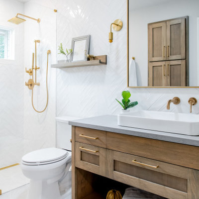 Example of a large transitional 3/4 white tile gray floor and single-sink alcove shower design in Austin with shaker cabinets, light wood cabinets, a two-piece toilet, a vessel sink, gray countertops and a built-in vanity