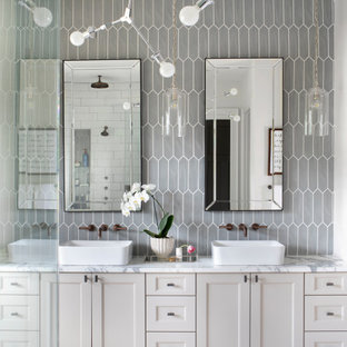 Large farmhouse master gray tile and ceramic tile porcelain tile and white floor bathroom photo in Atlanta with shaker cabinets, beige cabinets, white walls, a vessel sink, marble countertops, a hinged shower door and white countertops
