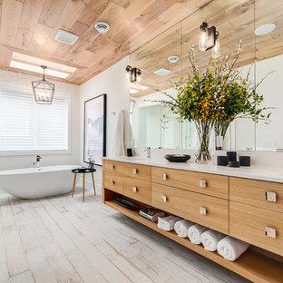 Inspiration for a large farmhouse master white tile porcelain floor and white floor freestanding bathtub remodel