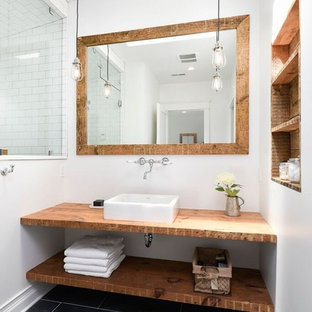 Small country 3/4 bathroom in Chicago with open cabinets, medium wood cabinets, a corner shower, white tile, subway tile, white walls, a vessel sink, wood benchtops and brown benchtops.