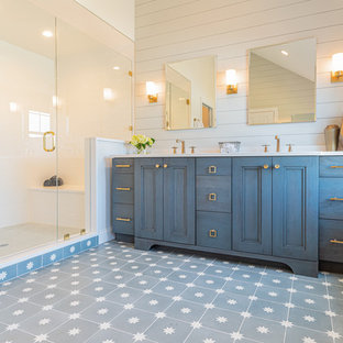 Large country master white tile and porcelain tile cement tile floor and blue floor alcove shower photo in Philadelphia with recessed-panel cabinets, blue cabinets, a one-piece toilet, white walls, an undermount sink, quartzite countertops, a hinged shower door and white countertops