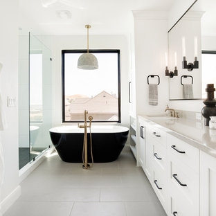 Bathroom - mid-sized transitional master white tile and ceramic tile ceramic floor and gray floor bathroom idea in Salt Lake City with shaker cabinets, white cabinets, white walls, an undermount sink and gray countertops