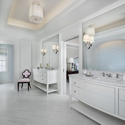 Huge beach style master travertine floor and white floor bathroom photo in Detroit with furniture-like cabinets, white cabinets, white walls, an undermount sink, marble countertops and white countertops