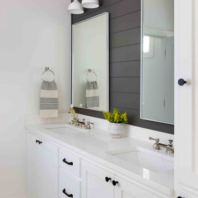 Inspiration for a mid-sized country 3/4 porcelain tile and gray floor bathroom remodel in Austin with shaker cabinets, white cabinets, white walls, an undermount sink and white countertops