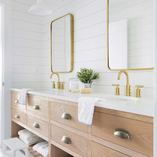 This is an example of a rural family bathroom in Minneapolis with freestanding cabinets, light wood cabinets, white walls, mosaic tile flooring, a submerged sink, white floors and white worktops.