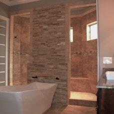 Mediterranean Bathroom by Homes of Distinction, Inc.