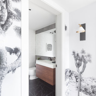 Example of a minimalist white tile black floor and single-sink bathroom design in Vancouver with dark wood cabinets, white walls, white countertops and a floating vanity