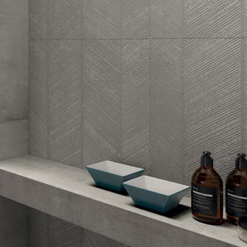Modern grey bathroom with cement look porcelain tiled walls and floor