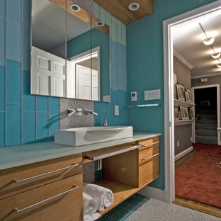 Inspiration for a large contemporary 3/4 blue tile and glass tile porcelain floor corner shower remodel in DC Metro with a vessel sink, flat-panel cabinets, light wood cabinets, engineered quartz countertops and blue walls