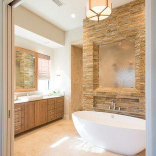 Inspiration för klassiska badrum, med ett fristående handfat, skåp i shakerstil, skåp i mellenmörkt trä, ett fristående badkar, brun kakel, stenkakel och vita väggar