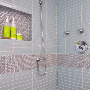 Large trendy master blue tile and glass tile mosaic tile floor doorless shower photo in Chicago
