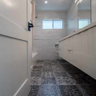 Example of a mid-sized minimalist kids' beige tile and ceramic tile gray floor and cement tile floor bathroom design in San Francisco with flat-panel cabinets, a bidet, beige walls, an undermount sink, granite countertops, white countertops and white cabinets