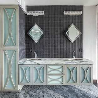 Example of a trendy gray tile bathroom design in Detroit with glass-front cabinets, gray cabinets and an undermount sink