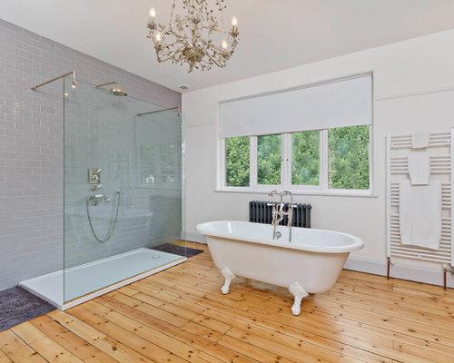 example of a trendy bathroom design in sussex with a claw foot tub - En Suite Bathrooms Designs