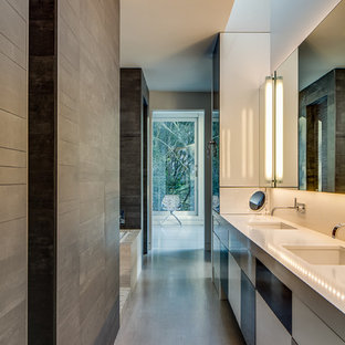 Bathroom - modern bathroom idea in San Francisco with an undermount sink, flat-panel cabinets, engineered quartz countertops and white countertops