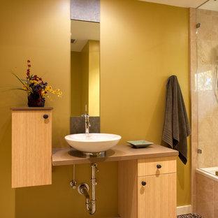 Idées déco pour une salle de bain contemporaine avec une vasque.