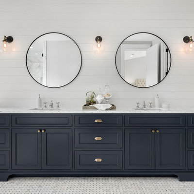 Cottage master gray floor freestanding bathtub photo in DC Metro with beaded inset cabinets, black cabinets, white walls, an undermount sink and white countertops