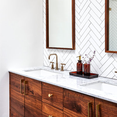 Example of a transitional master white tile blue floor bathroom design in Philadelphia with flat-panel cabinets, medium tone wood cabinets, white walls and an undermount sink
