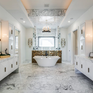 Large tuscan master marble tile and gray tile marble floor and gray floor bathroom photo in Dallas with flat-panel cabinets, white cabinets, white walls, marble countertops, a hinged shower door, an undermount sink and gray countertops