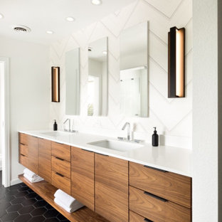 Example of a mid-sized trendy master porcelain tile and black floor bathroom design in Denver with flat-panel cabinets, medium tone wood cabinets, white walls, an undermount sink and white countertops