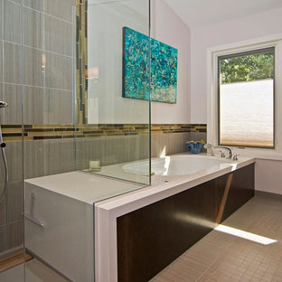 Mid-sized minimalist master gray tile and porcelain tile porcelain floor and beige floor corner shower photo in St Louis with flat-panel cabinets, dark wood cabinets, a two-piece toilet, white walls, an undermount sink, an undermount tub, engineered quartz countertops and a hinged shower door