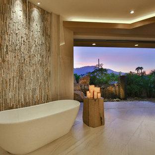 На фото: класса люкс огромные главные ванные комнаты в современном стиле с отдельно стоящей ванной, полом из керамогранита, бежевой плиткой, каменной плиткой, бежевыми стенами, бежевым полом, открытым душем и открытым душем