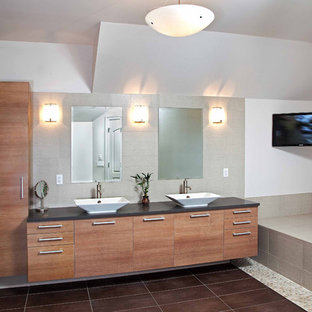 Example of a large trendy master brown tile and pebble tile bathroom design in Newark with a vessel sink, flat-panel cabinets, medium tone wood cabinets and gray walls