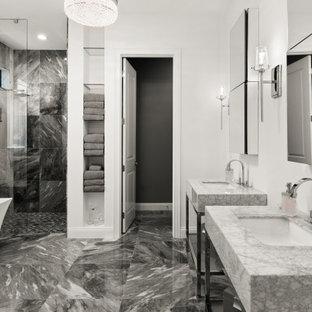 Immagine di un'ampia stanza da bagno padronale minimalista con nessun'anta, ante grigie, vasca freestanding, doccia a filo pavimento, WC monopezzo, pareti nere, pavimento in marmo, lavabo a colonna, top in marmo, pavimento grigio, doccia aperta e top grigio
