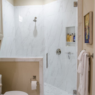 Example of a mid-sized tuscan 3/4 beige tile and ceramic tile ceramic floor and beige floor bathroom design in Austin with raised-panel cabinets, white cabinets, a two-piece toilet, beige walls, an undermount sink and limestone countertops