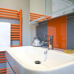 Modern, minimal family bathroom with orange accents - Burgess Hill