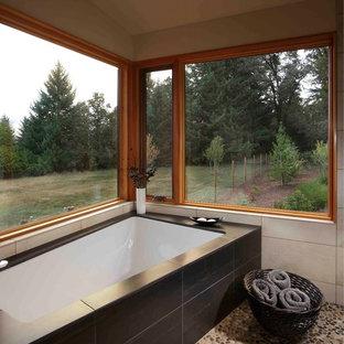 Doorless shower - mid-sized contemporary master beige tile pebble tile floor doorless shower idea in Portland with an undermount sink, beige walls and an undermount tub