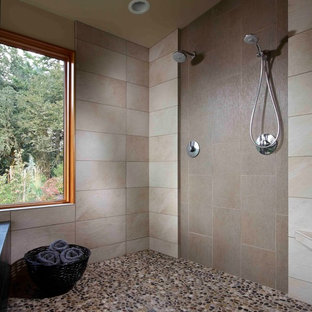 Example of a mid-sized trendy master beige tile and ceramic tile pebble tile floor bathroom design in Portland