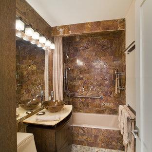 Bathroom - contemporary stone tile bathroom idea in New York with a vessel sink
