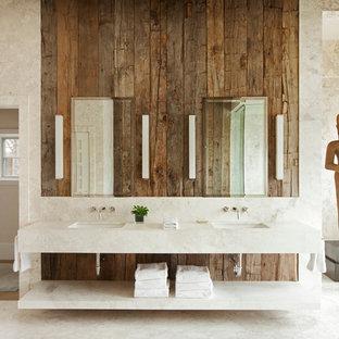 Imagen de cuarto de baño principal, rural, grande, con lavabo bajoencimera, armarios abiertos, encimera de mármol, paredes beige, suelo de mármol, baldosas y/o azulejos beige y baldosas y/o azulejos de mármol