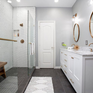 Small danish 3/4 white tile and porcelain tile porcelain floor and gray floor bathroom photo in Dallas with shaker cabinets, white cabinets, a drop-in sink, marble countertops, gray walls and gray countertops