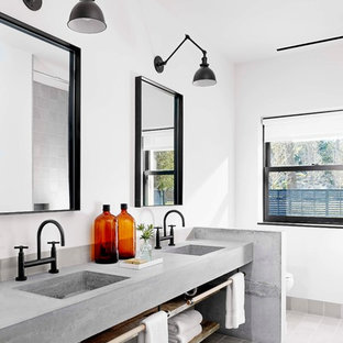 Urban master bathroom photo in Austin with an integrated sink and concrete countertops