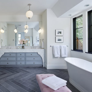 Example of a transitional master white tile and porcelain tile porcelain floor bathroom design in Minneapolis with flat-panel cabinets, gray cabinets, white walls, an undermount sink and marble countertops