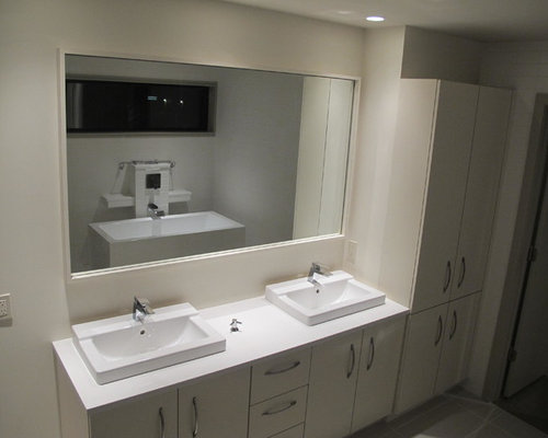 saveemail modern urban bathroom with white high gloss cabinets kansas city missouri