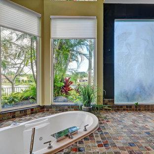 Island style master black tile and slate tile slate floor bathroom photo in Miami with yellow walls