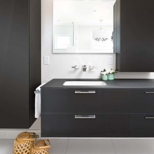 Mid-sized trendy master medium tone wood floor bathroom photo in Chicago with furniture-like cabinets, gray cabinets and glass countertops