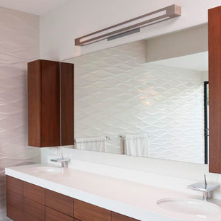 Large modern master bathroom in Miami with a corner shower, white tile, white walls, bamboo floors, brown floor, flat-panel cabinets, brown cabinets, a drop-in sink and granite benchtops.